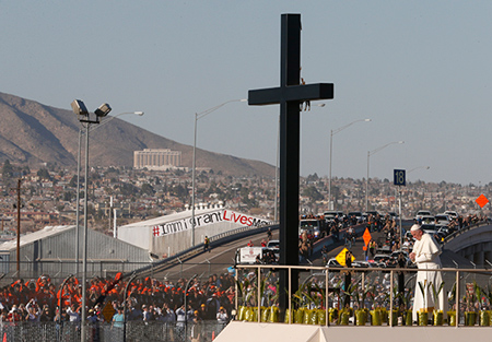 Pope Francis prays at a cross on the border with El Paso, Texas, before celebrating  Mass at the fairgrounds in Ciudad Juarez, Mexico, Feb. 17. CNS photo/Paul Haring