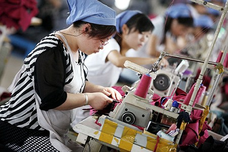 Workers make clothes to be exported at a clothing factory in Huaibei, China, June 1, 2015. CNS photo/Stringer, EPA
