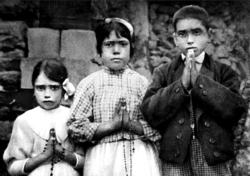 Portuguese shepherd children Lucia dos Santos, center, and her cousins, Jacinta and Francisco Marto, are seen in a file photo taken around the time of the 1917 apparitions of Mary at Fatima. CNS photo/EPA