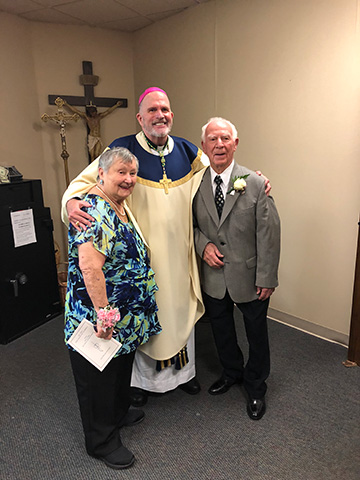 Bishop David M. O'Connell, C.M., personally congratulates the Paolillos, who marked 75 years of marriage at the Freehold Mass.  Courtesy photo