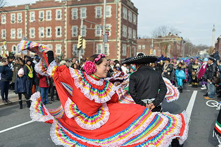 A dancer's skirt twirls around her as she dances in the Our Lady of Guadalupe procession in Trenton. Craig Pittelli photos