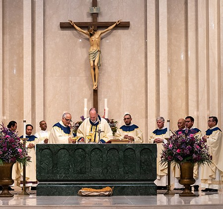 Bishop O'Connell is joined at the altar by a dozen priest concelebrants during the Mass to mark the opening of the Simbang Gabi novena in Monmouth County. Vic Mistretta photos