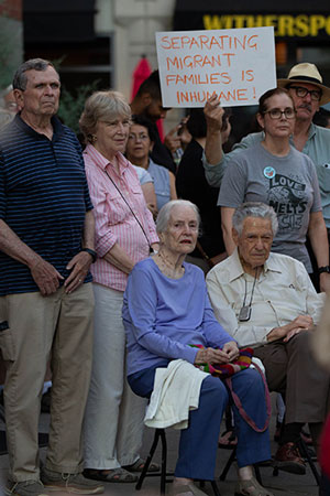 "Lenore Isleib and her husband, Leigh, of St. Anthony of Padua Parish, Hightstown, left, attend the ""Lights for Liberty"" vigil July 12 at Hinds Plaza, Princeton. Seated in front of the couple are Dr. Anne Barstow and Dr. Tom Driver, who are both active in Dutch Neck Presbyterian Church, West Windsor, as well as with social justice issues.  Rich Hundley photos"