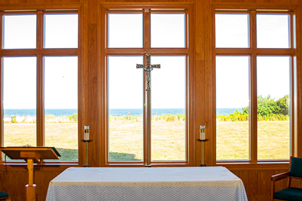 "Peaceful Vistas • Stella Maris Retreat Center, with stunning views of the Atlantic Ocean like this one from its chapel window, offered retreatants an ""experience of God's presence.""  Photos courtesy of Stella Maris Retreat Center"