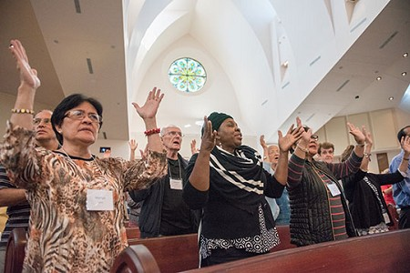 Worship The Lord -- Participants join in praise and worship at the Charismatic Conference.