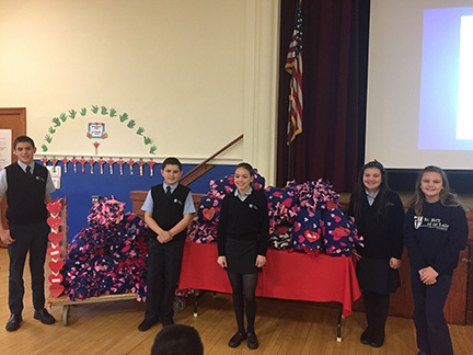 St. Mary of the Lakes students stand with the fleece blankets the schoolchildren made and donated to Covenant House of Camden. From left are eighth-grader Luke Denn, sixth-grader Artie Wheeler, seventh-grader Elizabeth Bell, fifth-grader Elena Bonfrisco and fourth-grader Ava Guaracino. Dubravka Kolumbic-Cortese photo