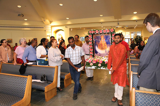 Processing Aug. 17 into St. David the King Church, Princeton Junction, Catholics celebrating origins in the Asian subcontinent carry  an image of Our Lady of Vailankanni, also known as Our Lady of Good Health, whose feast culminates on Sept. 8. John Batkowski photo
