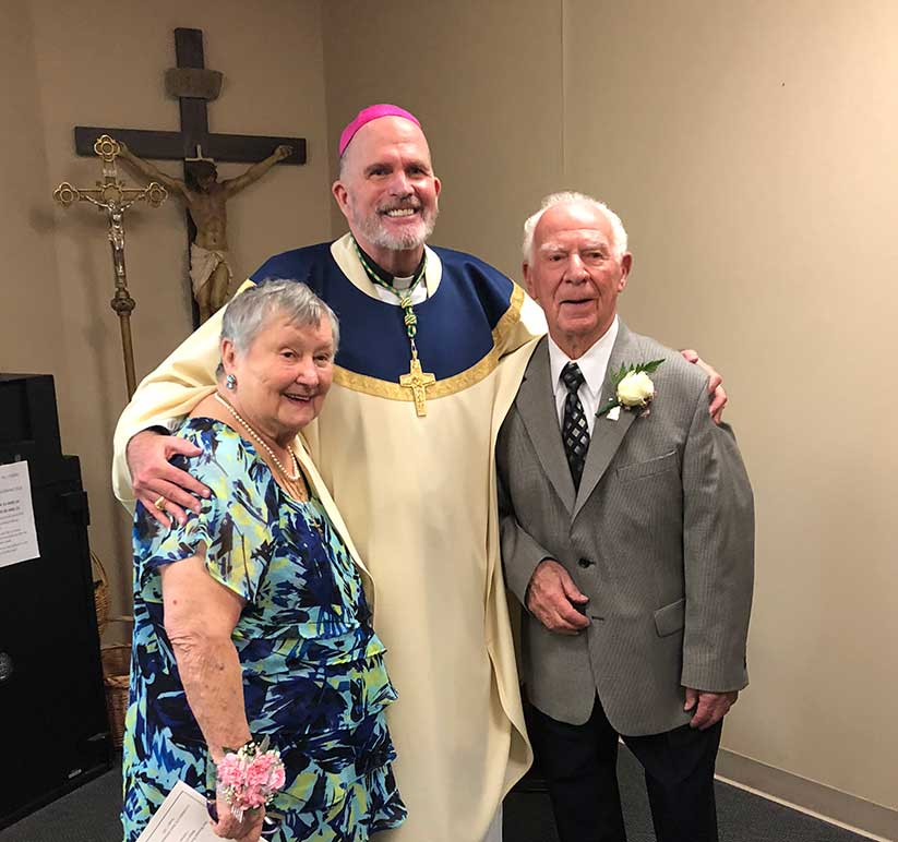 At the 2018 Anniversary Blessings Mass celebrated Oct. 7 in St. Robert Bellarmine Co-Cathedral, Freehold, Bishop David M. O'Connell, C.M., greets Frances and Ben Paolillo of St. Luke Parish, Toms River, who celebrated their 75th wedding anniversary. Courtesy photo