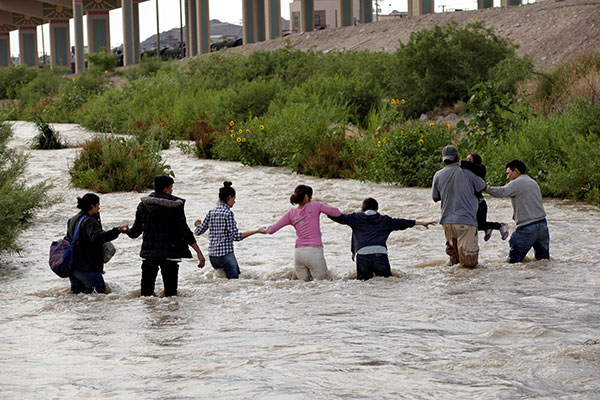 Migrants from Central America seeking asylum in the United States cross the Rio Grande near Ciudad Juarez, Mexico, June 11. CNS photo/Jose Luis Gonzalez, Reuters