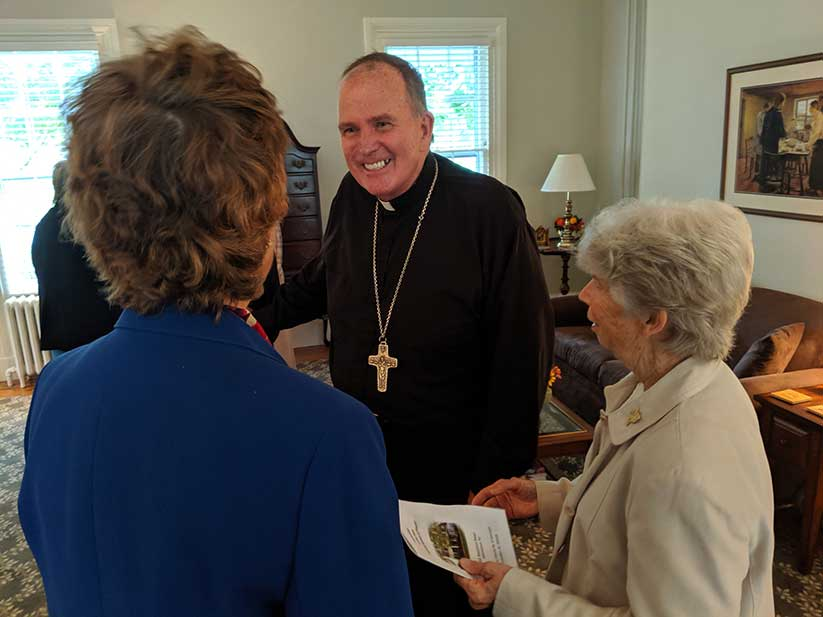 Following the Mass, Bishop O'Connell greets Francis House of Prayer staff, including Sister of St. Joseph Marcy Springer, director, at right. John Batkowski photo