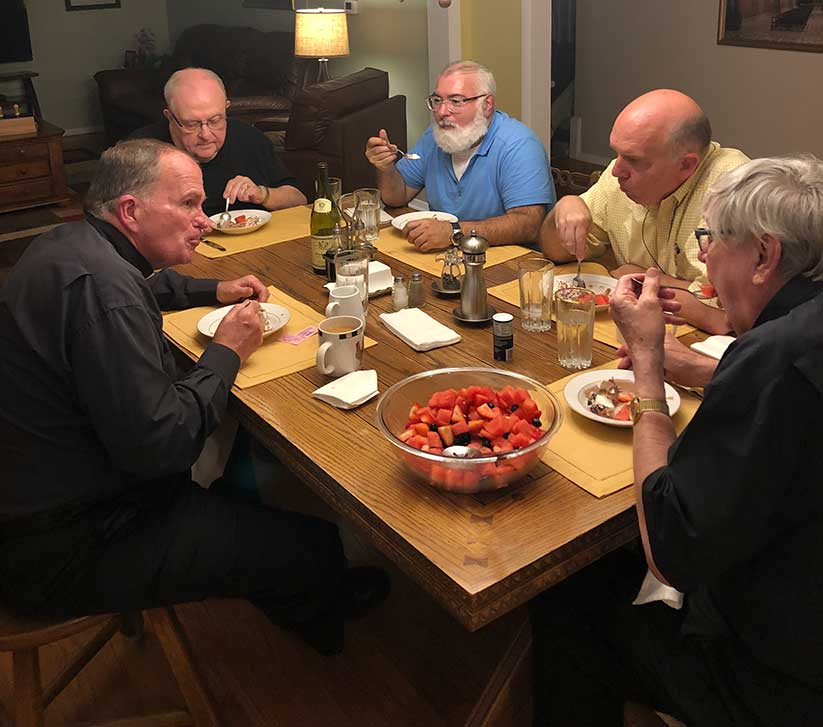 Bishop O'Connell enjoys dinner and conversation with the Franciscan priests of St. Peter Parish.