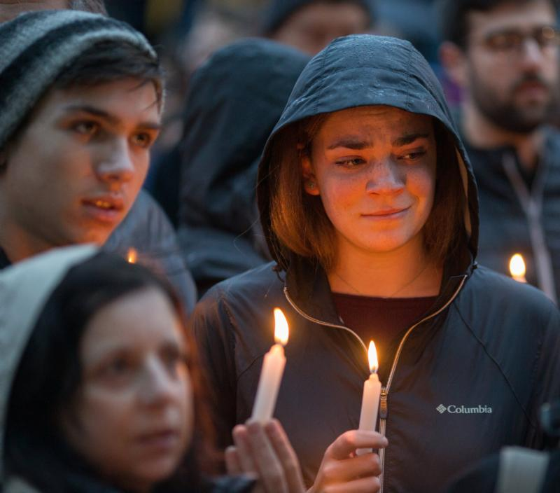 People mourn during a candlelight vigil Oct. 27, 2018, for victims of the shooting that killed eleven people at the Tree of Life Synagogue in Pittsburgh. In light of continued attacks on houses of worship and holy sites around the world, the U.S. Commission on International Religious Freedom held an Oct. 23, 2019, hearing at the Capitol to learn ways to deter such attacks. CNS photo/John Altdorfer, Reuters