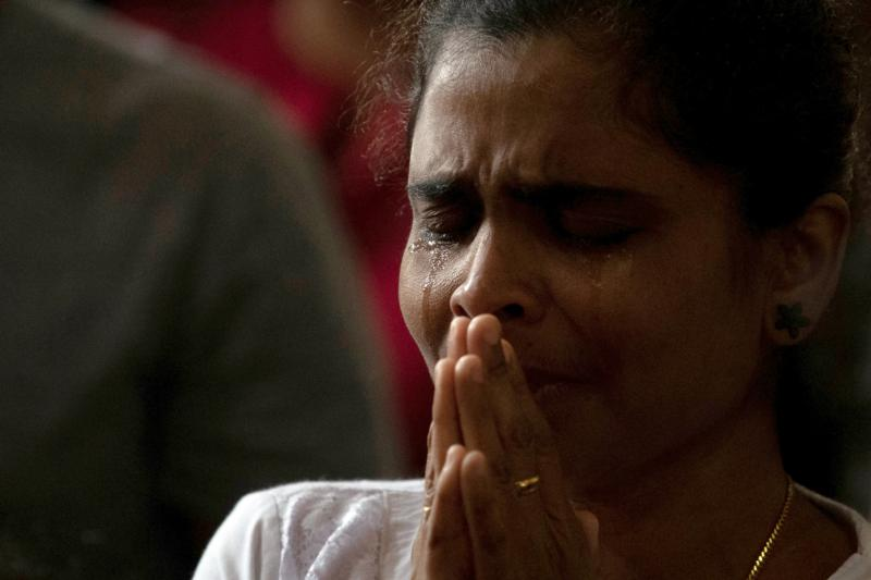 A member of Zion Church, which was bombed on Easter, cries as she prays at a community hall in Batticaloa, Sri Lanka, May 5, 2019. In light of continued attacks on houses of worship and holy sites around the world, the U.S. Commission on International Religious Freedom held an Oct. 23, 2019, hearing at the Capitol to learn ways to deter such attacks. CNS photo/Danish Siddiqui, Reuters