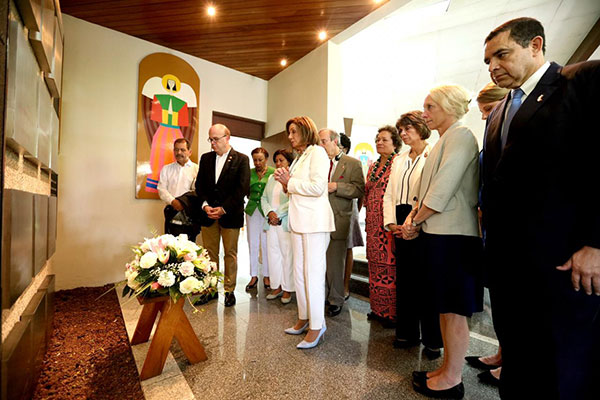 U.S. Rep. Jim McGovern, second from the left in a black jacket, stops with a congressional delegation in August 2019 at Central American University in San Salvador where six murdered Jesuit priests who greatly influenced his work and faith are buried. McGovern led the delegation to El Salvador to study causes of migration. CNS photo/courtesy Congressman Jim McGovern