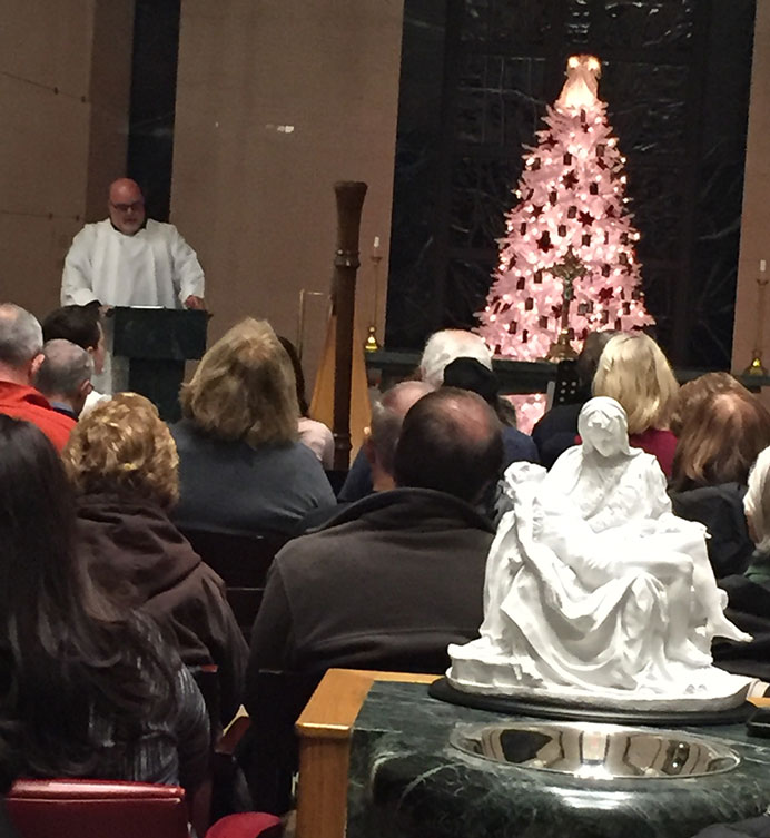 Deacon David O'Connor addresses family members and friends of deceased in Jesus Bread of Life Cemetery and Mausoleum, Hainesport, during the first Advent Celebration and Heavenly Christmas Tree Blessing Dec. 13. Dubravka Kolumbic-Cortese photo