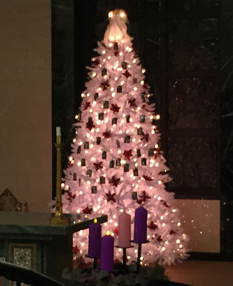 Pictured is the newly lit white Christmas  tree in Jesus Bread of Life Cemetery and Mausoleum. Families were invited to hang framed photos of their loved ones on the tree.