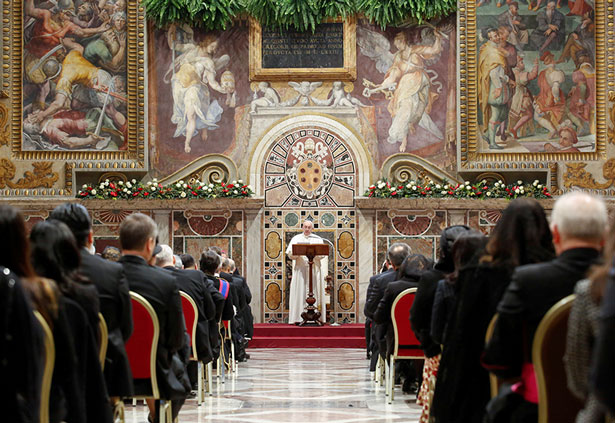 Pope Francis addresses diplomats accredited to the Holy See during an audience for the traditional exchange of new year's greetings in the Sala Regia at the Vatican Jan 9, 2020. CNS photo/Remo Casilli, Reuters pool