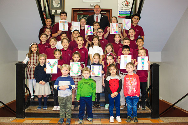 "Students in St. Leo the Great School, Lincroft, hold up a big ""Thank You"" sign after generous donors helped the school surpass its Giving Tuesday goal. Principal Cornelius Begley is seen in back. Courtesy photo"