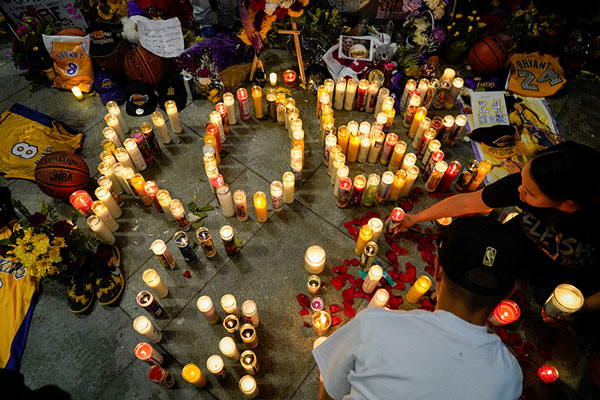 Mourners gather near the Staples Center Jan. 27, 2020, to pay respects to former Los Angeles Lakers star Kobe Bryant after he, his daughter Gianna, 13, and seven others were killed Jan. 26 in a helicopter crash in Calabasas, Calif. CNS photo/Kyle Grillot, Reuters