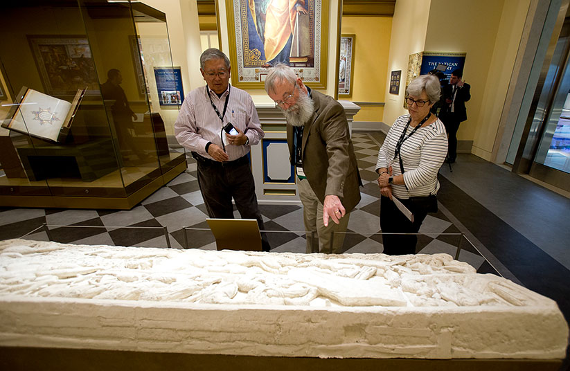 "Brian Hyland, associate curator from Oklahoma City, interprets a sarcophagus replica of Jonah inside the ""Vatican Museums and Vatican Library"" exhibit at the Museum of the Bible in Washington Nov. 15, 2017. Museum officials announced an investigation they commissioned has confirmed 16 papyrus fragments supposedly from Dead Sea Scrolls are not authentic. CNS photo/Tyler Orsburn"