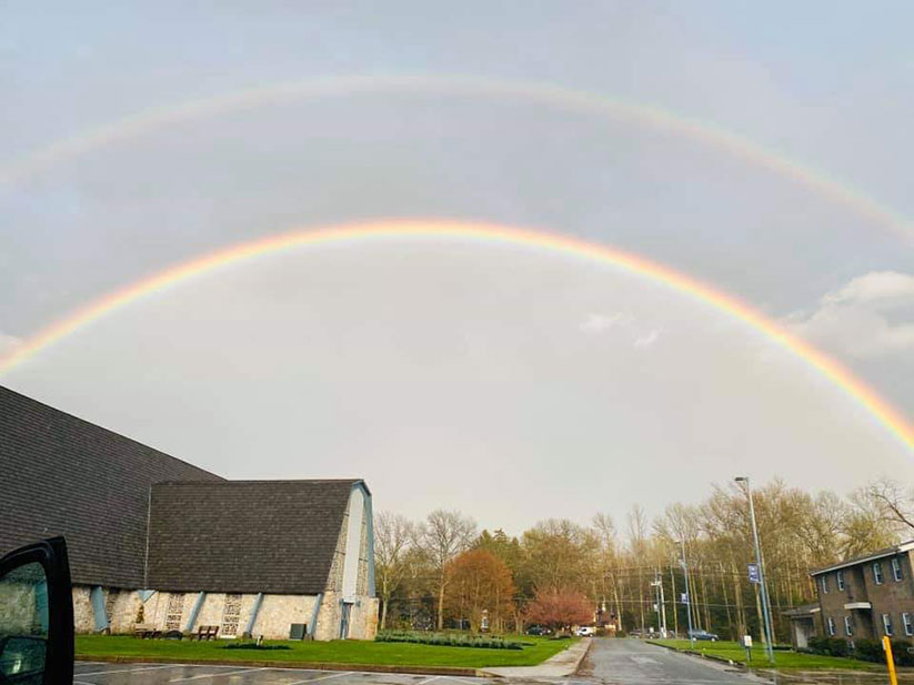A double rainbow arches over St. Mary of the Lakes Church, Medford. Courtesy photo