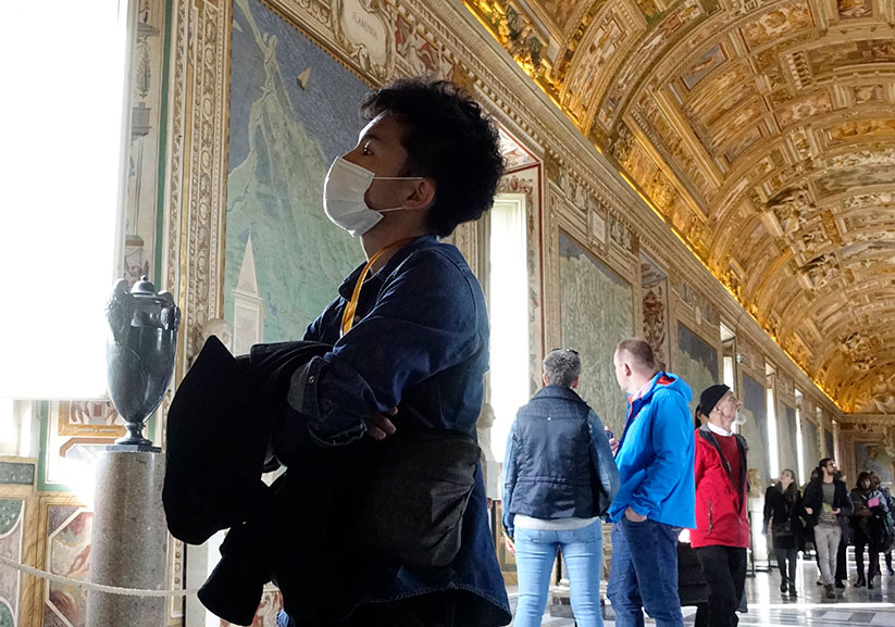A visitor wears a mask for protection from the coronavirus Feb. 29 while touring the Vatican Museums. The Vatican Museums will have new measures and protocols in place to ensure the safety of visitors when they reopen. CNS photo/Paul Haring