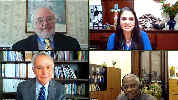 A screen grab shows participants in an online dialogue on the COVID-19 pandemic May 12. Clockwise from top right: Haydee Diaz of Catholic Relief Services; Cardinal Peter Turkson, prefect of the Dicastery for Promoting Integral Human Development; David Beckmann of Bread for the World; and John Carr of Georgetown University's Initiative on Catholic Social Thought and Public Life. CNS photo/courtesy Georgetown University