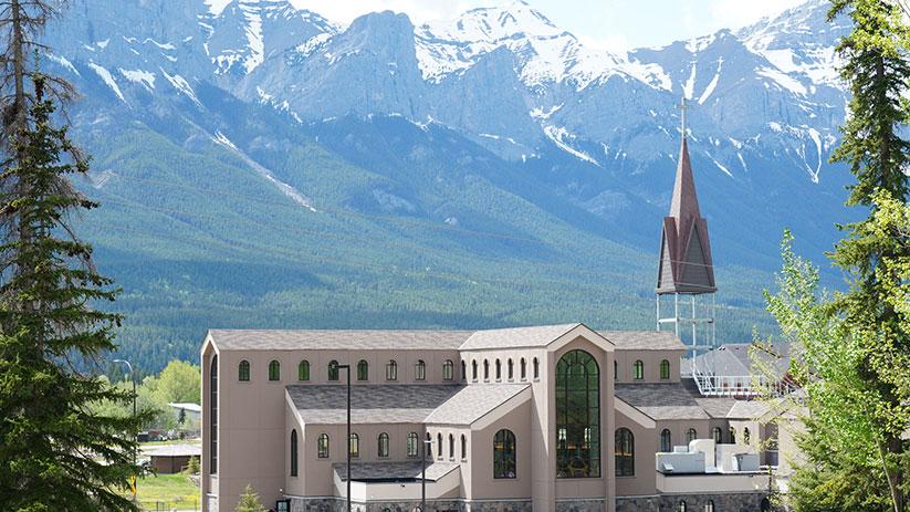 This is a view of the new Our Lady of the Rockies Church in Canmore, Alberta. Bishop William McGrattan of Calgary celebrated Mass at the church May 30, designating it as the first Marian shrine in the Diocese of Calgary. CNS photo/Lincoln Ho, Grandin Media