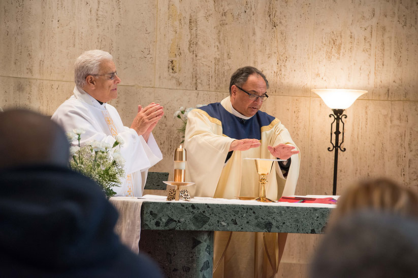 Father Carmen Carlone, left, concelebrates Mass with Msgr. Thomas N. Gervasio, diocesan vicar general, in the chapel of St. Francis Medical Center, Trenton, during a World Day of the Sick observance. Monitor file photo