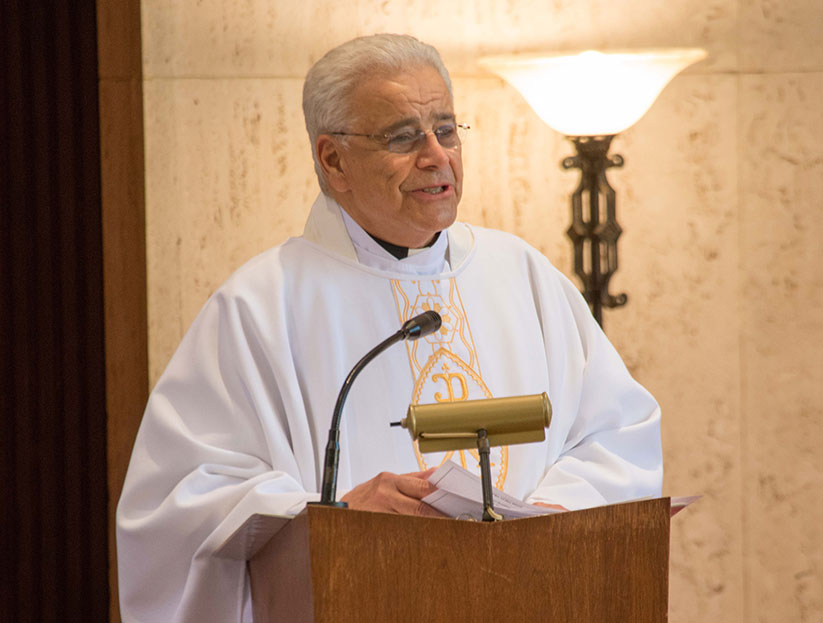 Father Carmine Carlone preaches a homily during a Mass celebrated for World Day of the Sick in the chapel of St. Francis Medical Center, Trenton. Monitor file photo