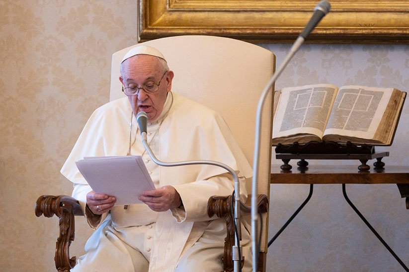 Pope Francis leads his general audience in the library of the Apostolic Palace at the Vatican Aug. 19, 2020. The pope said that the church's preferential option for the poor includes making sure any vaccine developed for COVID-19 helps everyone. CNS photo/Vatican Media