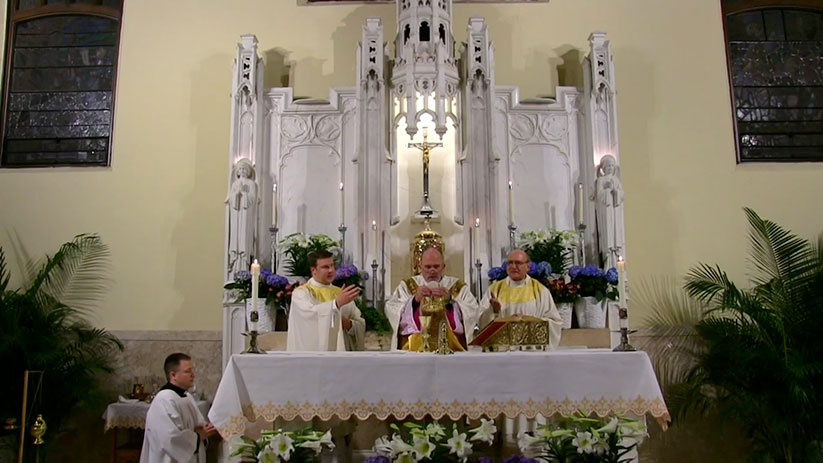 Funds from the COVID-19 Emergency Relief Fund helped parishes stay connected with their communities during the lockdown. Here, St. Rose Church, Belmar, livestreams the Easter Vigil Mass,  celebrated April 11 by Bishop David M. O'Connell, C.M. File photo