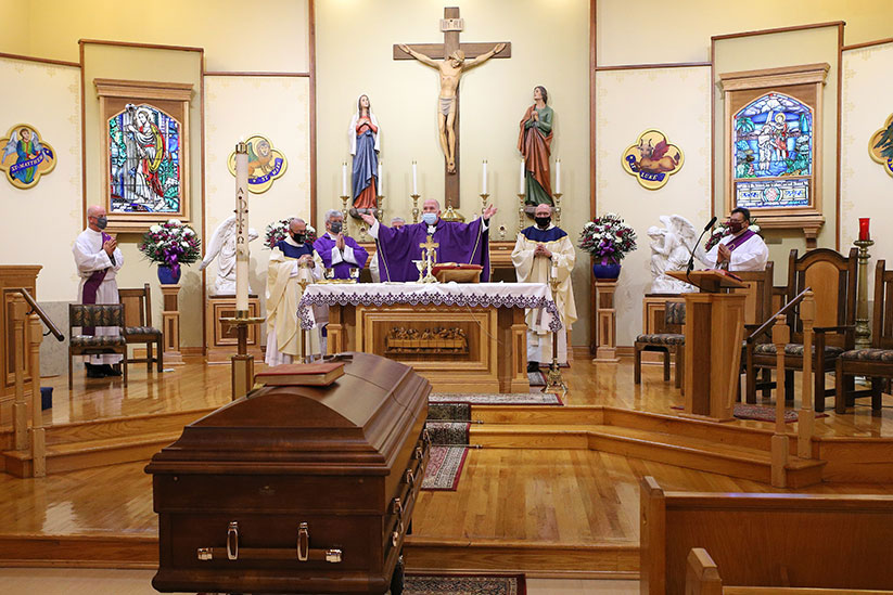 Bishop David M. O'Connell, C.M., celebrates a funeral Mass Nov. 25 in St. Leo the Great Church, Lincroft, for Father Rocco A. Cuomo, a retired priest of the Diocese who died Nov. 21. John Batkowski photos
