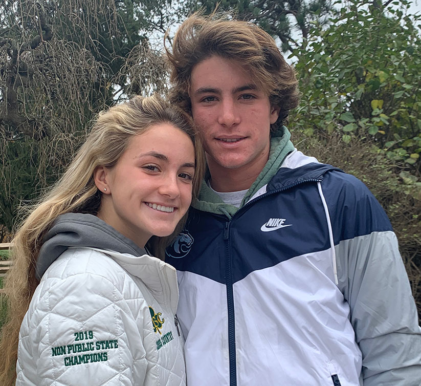Siblings Cate and Chris DeSousa, who attend Catholic schools, both won a Non-Public A individual sectional title in cross country in mid-November. Photo courtesy of Cynthia DeSousa