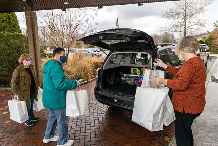 Volunteers in St. Clement Parish, Matawan, prepare to deliver packages of Thanksgiving meals to senior citizens living in the area Catholic News Service columnist Effie Caldarola focuses on the topic of generosity especially now during the Christmas season. Hal Brown photo
