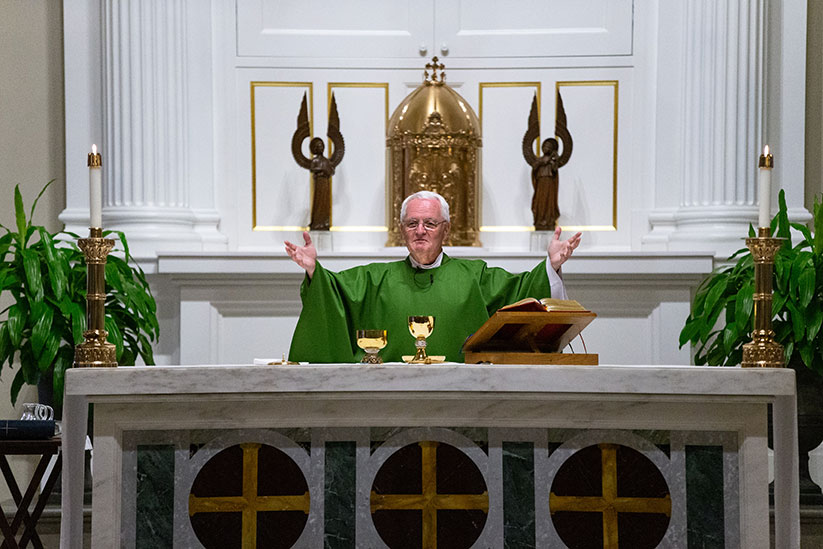 "Father Michael Manning, pastor of Holy Cross Parish, Rumson, celebrates Mass. The vestments used by a priest and deacon at Mass during ""Ordinary Time"" are green in color, which represents hope in Christ's Resurrection. Rich Hundley photo"