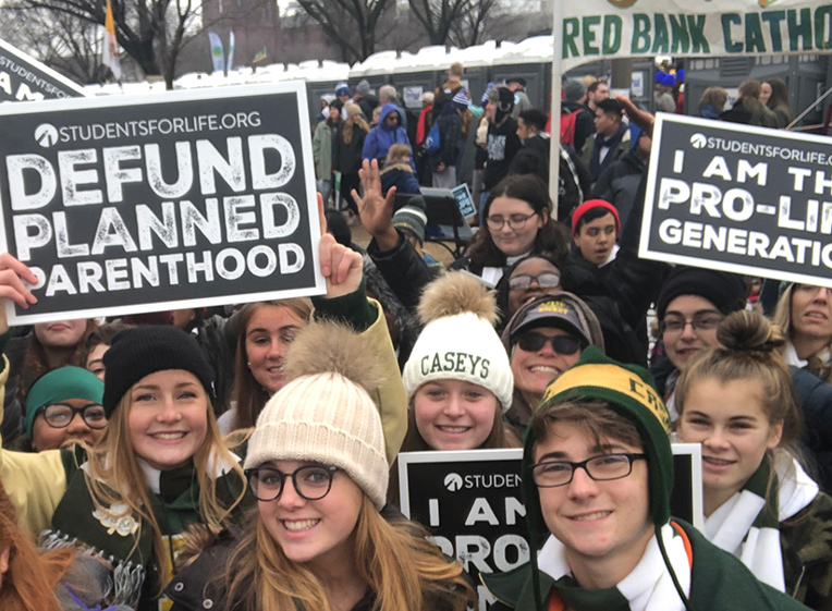 Students from Red Bank Catholic High School attend the 2019 March for Life in Washington. Due to the pandemic, high school students across the Diocese will be making their pro-life voices heard in a different way in January – a friendly competition to collect items for mothers and fathers in need. File photo
