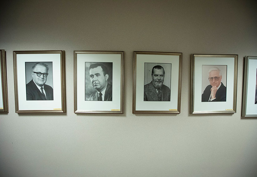 "Portraits of some of Catholic News Service's former directors and editors-in-chief hang on a wall at CNS headquarters in Washington. From left are Floyd Anderson (1963-1969), Richard Guilderson (1969-1972), A.E.P. ""Ed"" Wall (1972-1976) and Richard W. Daw (1976-1988). CNS photo/Tyler Orsburn"