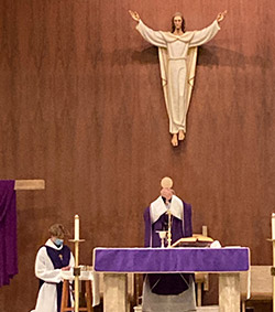 Divine Word Father Jan Pastuszczak consecrates the Eucharist during  Mass he celebrated for retreatants. Courtesy photos
