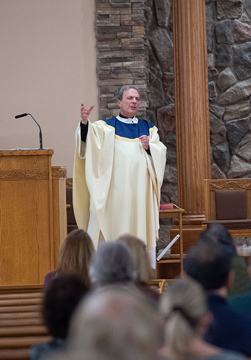 Father Lang preaches the homily in the Millstone parish. Mike Ehrmann photo